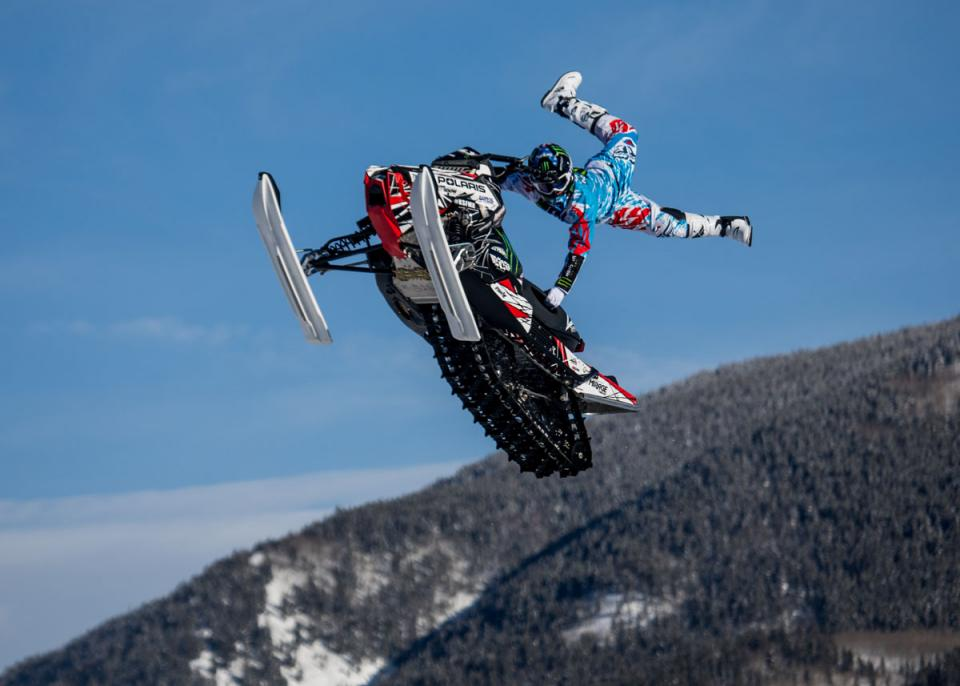 Heath Frisby competes in Snowmobile Freestyle
