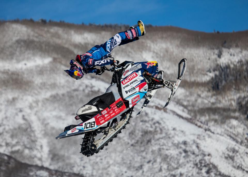 Levi LaVallee competes in snowmobile freestyle at Winter Xgames