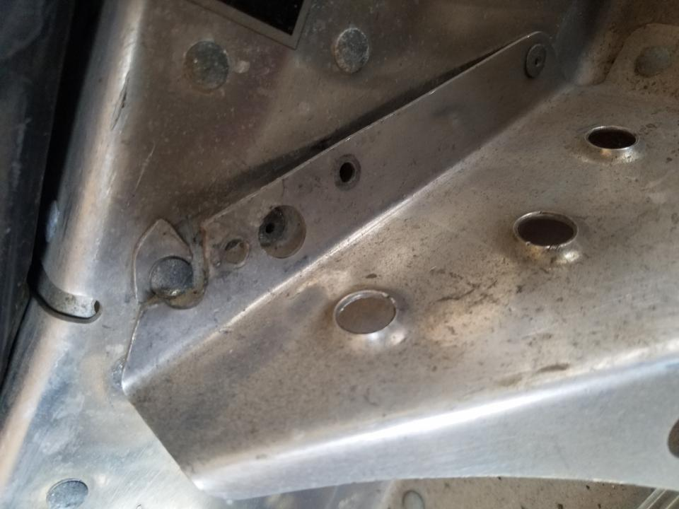 broken chassis support on a snowmobile